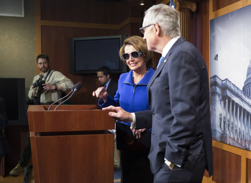 House Democratic Leader Nancy Pelosi (D-CA) wears sunglasses in solidarity with Senate Minority Leader Harry Reid (D-NV) during a news conference at the U.S. Capitol in Washington
