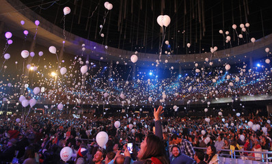 People release balloons in tribute to the late Argentine musician Gustavo Cerati, during the International Song Festival in Vina del Mar city