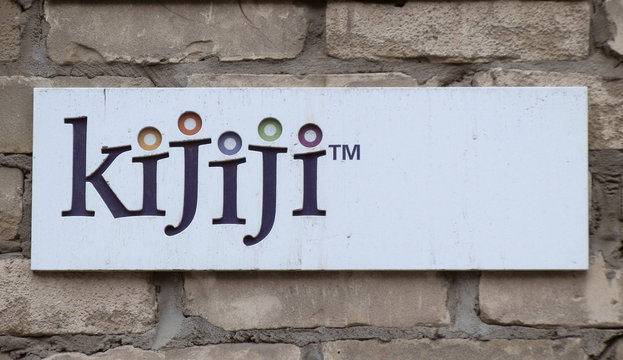 A sign hangs outside the offices of online marketplace Kijiji in Toronto