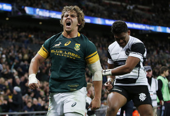 South Africa's Rohan Janse Van Rensburg celebrates after he scores a try