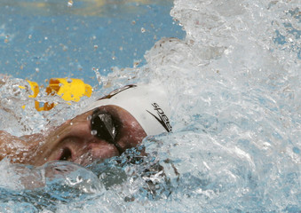 Santos of Brazil, representing the Flamengo Club, competes in the men's 100 m freestyle heats at the Maria Lenk Trophy swimming competition to qualify for the 2012 London Olympics in Rio de Janeiro