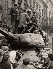 Fighters stand on top of a tank in Budapest at the time of the uprising against the Soviet-supported Hungarian communist regime in 1956
