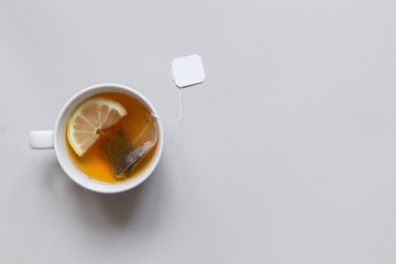 In de dag Thee Tea time. Cup of hot black tea on the blue background, top view