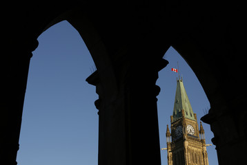 A Canadian flag flies at half-mast on the Peace Tower in memory of the victims of the fatal train disaster in Lac-Megantic, on Parliament Hill in Ottawa