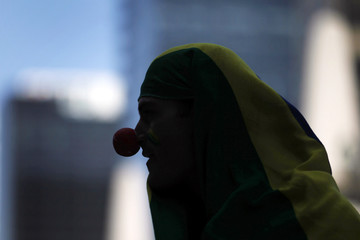 A Brazilian citizen, living in Mexico, wears a clown nose during a demonstration in Mexico City, in solidarity with a protest movement in Brazil