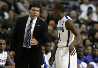 Memphis head coach Pastner talks with guard Jackson during stop in game action of first half of their second round NCAA tournament basketball game against Saint Mary's Gaels in Auburn Hills