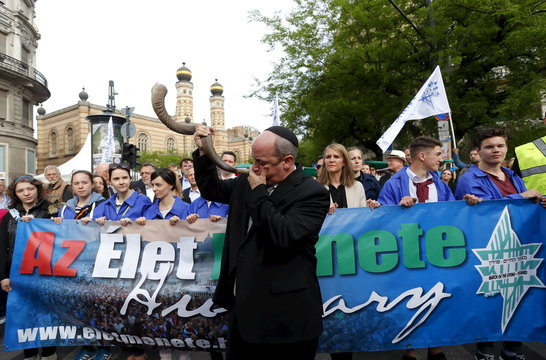 "Rabbi Veto blows a Shofar the annual ""March of the Living"" to commemorate the deaths of around half a million Hungarian Jews during the Holocaust in World War Two, in Budapest"