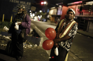 Homeless men take part during an event held to celebrate Christmas with the homeless in San Jose