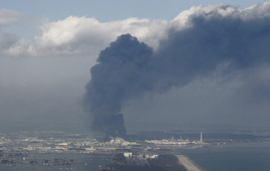 Smoke is seen rising from earthquake and tsunami devastated town of Sendai