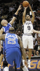 San Antonio Spurs Parker shoots over Dallas Mavericks' players during Game 4 of their NBA Western Conference playoff basketball series in San Antonio