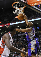 Suns Carter goes up for a slam dunk past Raptors Davis during their NBA basketball game in Toronto