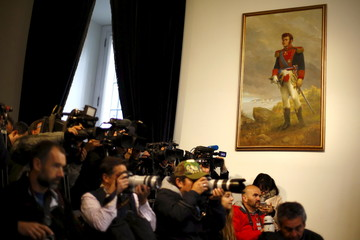 A painting of Chilean national hero Bernardo O'Higgins hangs in a room at the government palace in Santiago