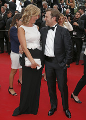 """French journalist Laurence Ferrari and her partner violinist Renaud Capucon pose on the red carpet as she arrives for the screening of the film """"Irrational Man"""" out of competition at the 68th Cannes Film Festival in Cannes"""