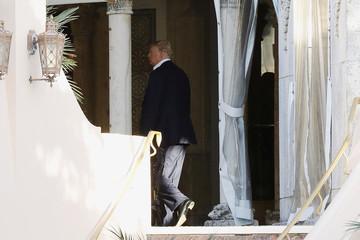 U.S. President-elect Donald Trump walks along a balcony at the Mar-a-Lago estate in Palm Beach, Florida