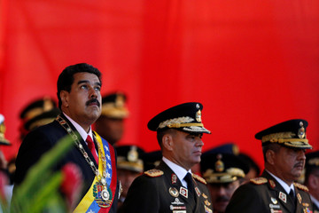 Venezuela's President Maduro attends a military parade to celebrate the 195th anniversary of the Battle of Carabobo, next to Venezuela's Defense Minister Lopez in Caracas