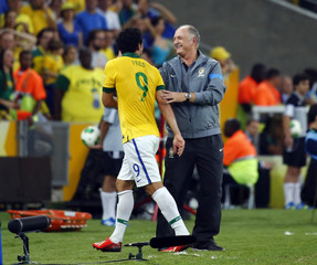 Brazil's coach Felipe Luiz Scolari congratulates Fred after he was substituted during their Confederations Cup final soccer match against Spain at the Estadio Maracana in Rio de Janeiro
