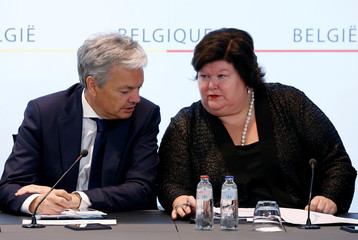Belgian Foreign Minister Reynders and Health Minister De Block attend a joint news conference with members of the federal government in Brussels