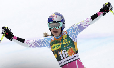 Vonn of the U.S. celebrates coming in third place after the women's giant slalom at the Alpine Ski World Cup race in Spindleruv Mlyn