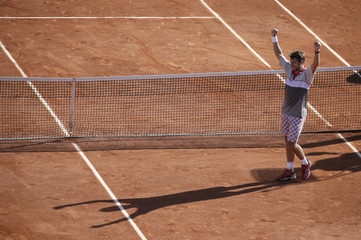 Stan Wawrinka of Switzerland celebrates after winning his men's singles final match against  Novak Djokovic of Serbia during the French Open tennis tournament at the Roland Garros stadium in Paris