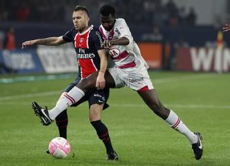 Paris St Germain's Menez challenges Bordeaux's Diabate during their French Ligue 1 soccer match at Parc des Princes stadium in Paris