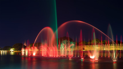 A cascade of colorful fountains at the walls of the Old City. Mandalay, Myanmar