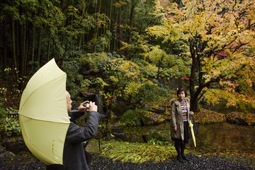 Visitors take pictures in garden of Suntory Holdings' Yamazaki Distillery in Shimamoto town