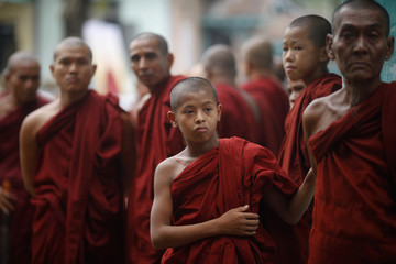 Buddhist monks wait for the funeral of a respected monk at Nyein Chan Yae monastery in Yangon