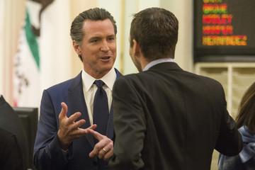 California Lt. Governor Gavin Newsom talks to lawmakers at the State Capitol in Sacramento California