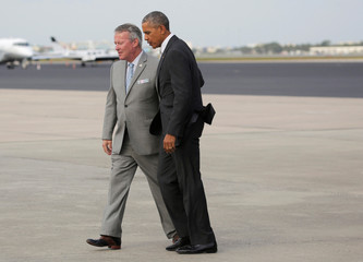 U.S. President Barack Obama is greeted by Orlando Mayor Buddy Dyer as he arrives for a Hillary for America campaign event in Orlando, Florida