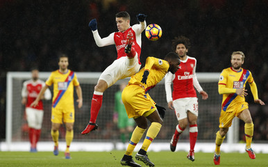 Arsenal's Gabriel Paulista in action with Crystal Palace's Christian Benteke