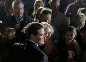U.S. Republican presidential candidate Marco Rubio takes a photo with a supporter following a campaign event in Chapin