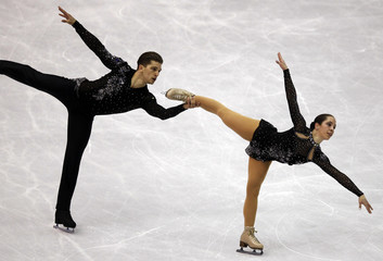 Monica and Guarise of Italy perform during the pairs free skating preliminary round at the ISU World Figure Skating Championships in Nice