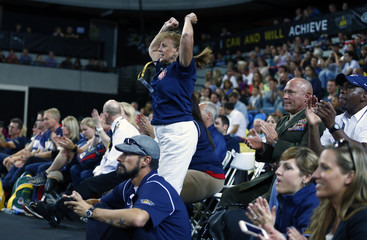 A fan cheers for the USA during their wheelchair basketball match against France at the Invictus Games in the Olympic Park in east London