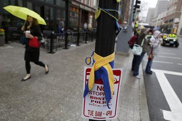 A pedestrian walks past site of one of the two bomb blasts on 2013 Boston Marathon bombings anniversary in Boston