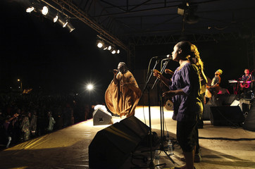 Ivorian reggae singer Tiken Jah Fakoly performs during a concert in the Abobo suburb of Abidjan