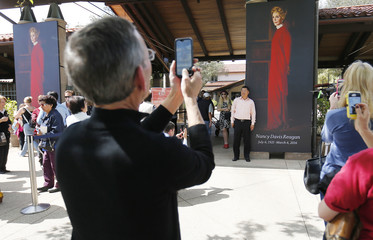 People take pictures of a portrait of  former first lady Nancy Reagan that greets visitors as they arrive to pay their respects at the Ronald Reagan Presidential Library in Simi Valley California