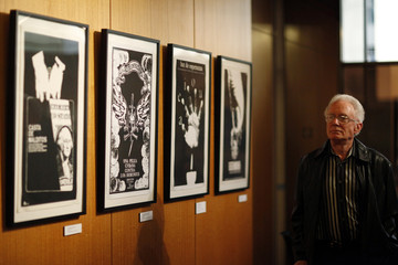 """A guest walks by movie posters part of the exhibit before a special screening of """"Strawberry and Chocolate"""" during """"A celebration of Cuban Film"""" event at the Academy of Motion Picture Arts and Sciences in Beverly Hills"""