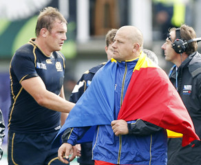 Scotland captain Alastair Kellock and Romania captain Marius Tincu react after their Rugby World Cup Pool B match at Rugby Park Stadium in Invercargill