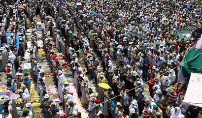 Supporters of ousted President Mursi perform weekly Friday prayers at Rabaa Adawiya square in Cairo