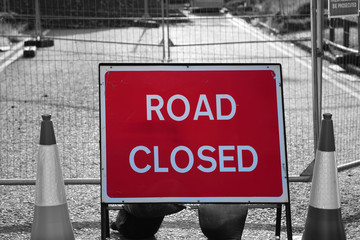 Road closed sign in roadworks with selective colour