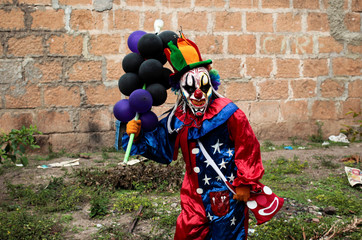 A reveller holds balloons during celebration of Virgen de los Desamparados at Diria town