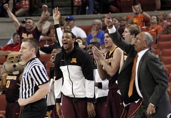 University of Minnesota players react after scoring against the University of California Los Angeles during their second round NCAA basketball game in Austin, Texas