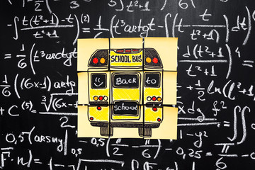 "Back to school background with title ""Back to school"" and ""school bus""  written on the yellow pieces of paper on the  chalkboard with math formulas written by chalk"