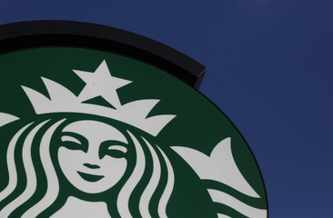 Starbucks logo is seen outside the new Starbucks cafe in Warsaw