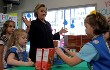 U.S. Democratic presidential candidate Hillary Clinton buys Girl Scouts' cookies during a campaign event in Ashland