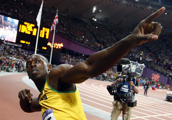 Jamaica's Usain Bolt gestures after winning  men's 100m final at London 2012 Olympic Games