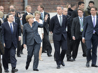 """German Chancellor  Merkel, European Commission President Barroso and Norway's Prime Minister Stoltenberg walk to the town hall during the """"Council of the Baltic Sea States"""" leader summit in Stralsund"""