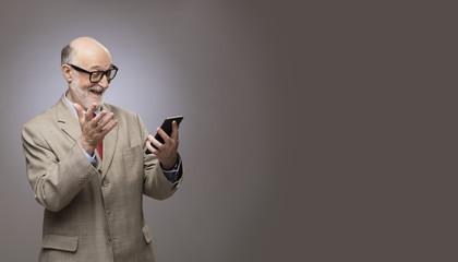 Senior man looking on phone