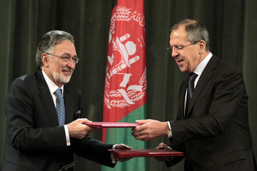 Russia's Foreign Minister Lavrov exchanges documents with his Afghan counterpart Rasul during a signing ceremony in Moscow