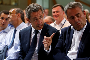 Nicolas Sarkozy, former head of the Les Republicains political party and a former French president gestures as he attends the party's weekend summer university youth meeting with Xavier Bertrand in Le Touquet-Paris-Plage